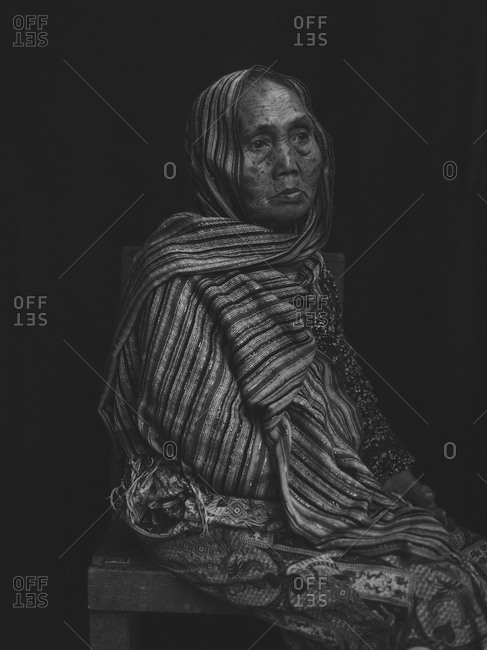 Bukidnon, Philippines - August 6, 2013: Marawi woman sitting in traditional dress, Philippines