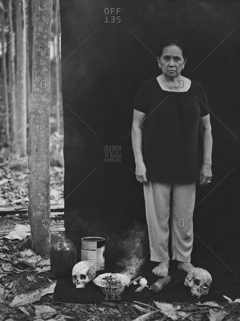 Siquijor, Philippines - September 11, 2013: Faith healer standing with skulls, Philippines