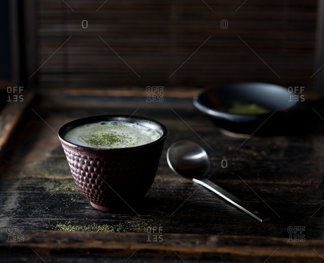 Green tea latte with matcha on dark background