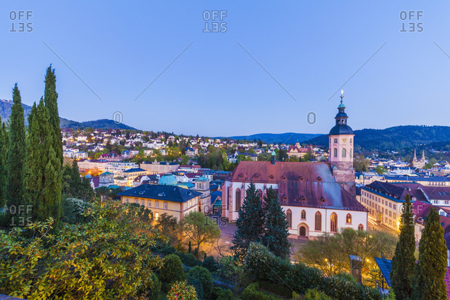 Cityscape with collegiate church in the evening