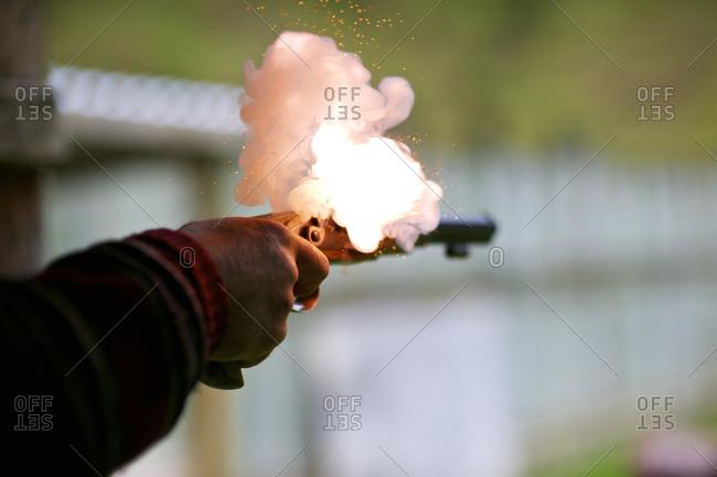A man fires a pistol