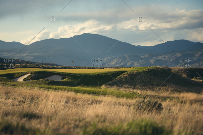 A golf course at the base of a mountain range in Kamloops, Canada