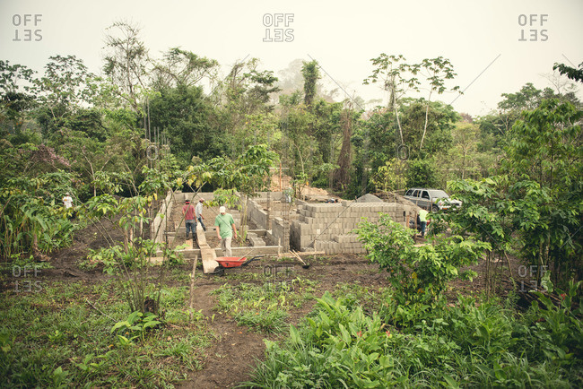 Guatemala - May 4, 2015: Workers build a building in the Guatemalan countryside