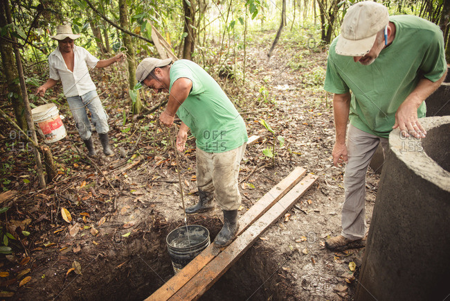 Guatemala - May 4, 2015: Workers construct a well in the Guatemalan countryside
