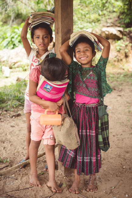 Guatemala - May 13, 2015: Three young girls carrying books in Guatemala