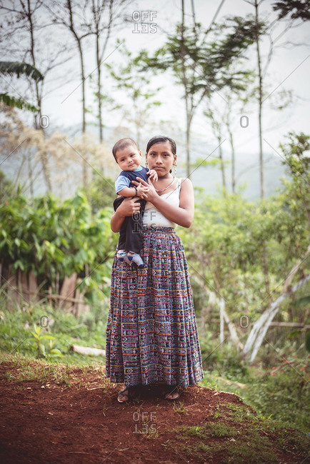 Guatemala - May 15, 2015: A woman and her child in a Guatemalan village