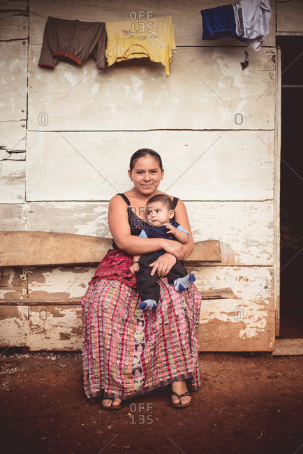 Guatemala - May 15, 2015: A woman holds a boy in a Guatemalan village