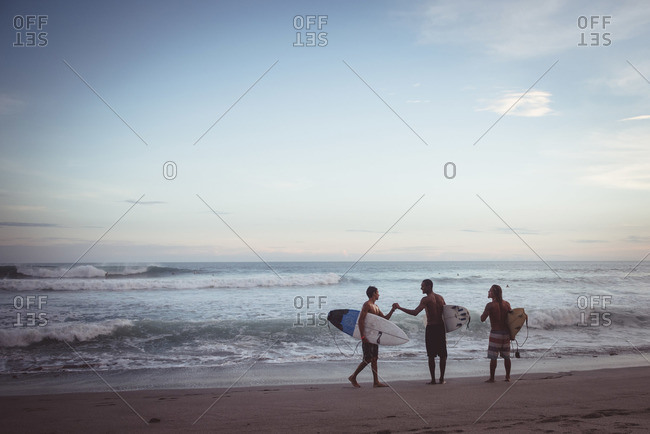 Nicaragua - June 9, 2015: Surfers embrace each other at the beach