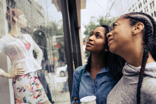 Two women look at a window display together