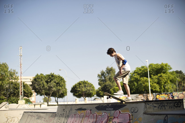 Boy skateboarding at a skate park