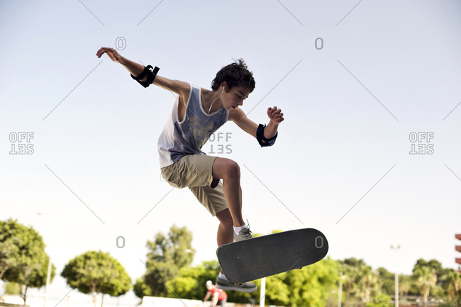 Teenaged boy on a skateboard