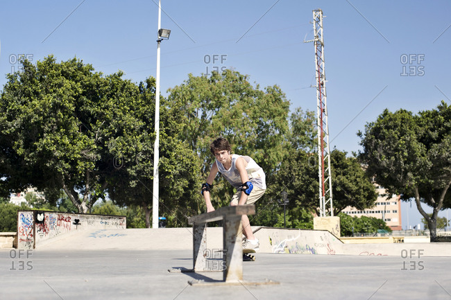 Teenaged boy at a skate park