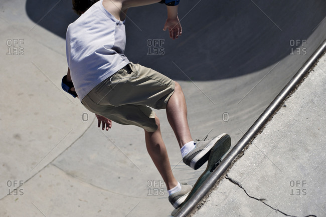 Teenaged boy on a skate ramp