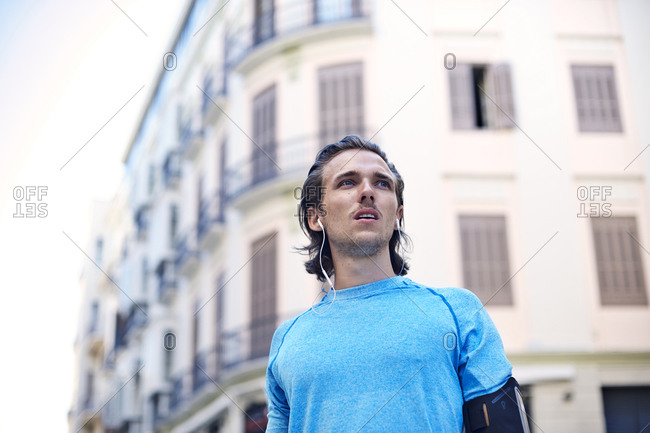 A jogger stands in the city