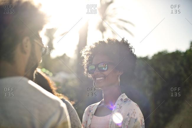 A woman smiles on a sunny beach