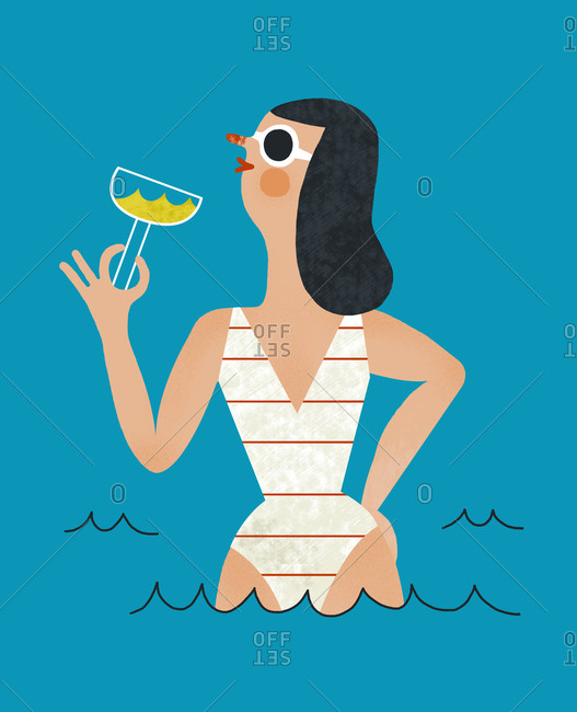 Woman in water holding a drink