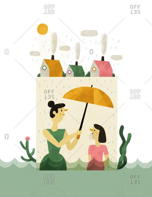 Woman and girl under an umbrella