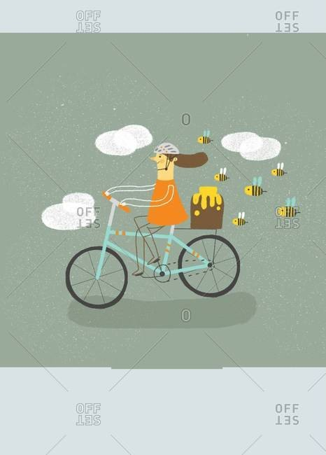 Girl riding a bicycle followed by bees