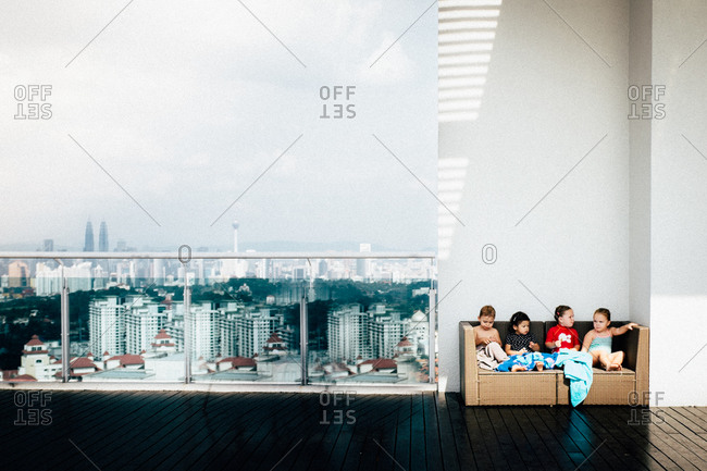 Group of children on a rooftop deck