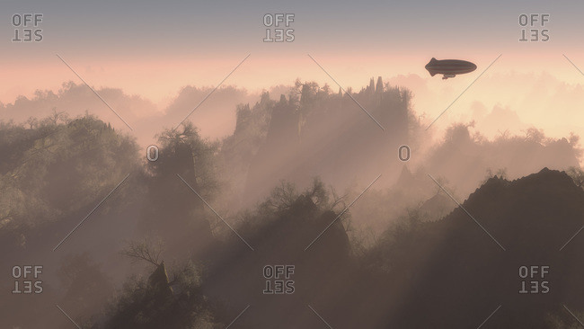 Rigid airship flying over mountain peaks