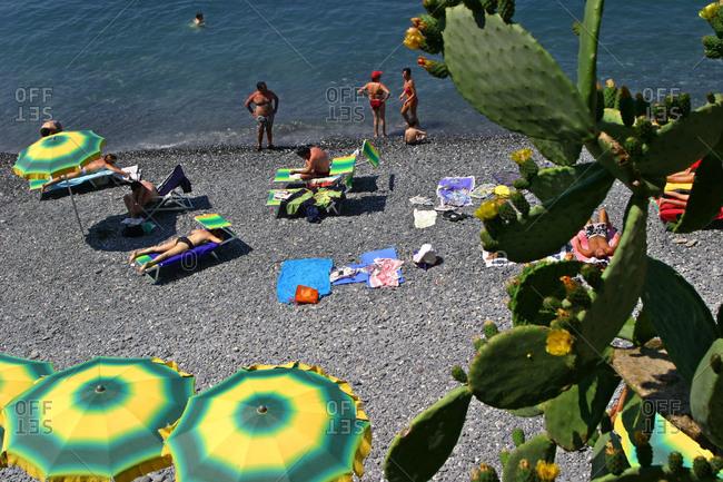 Italy, Liguria, Camogli - June 28, 2004: People swimming and sunbathing in Italy