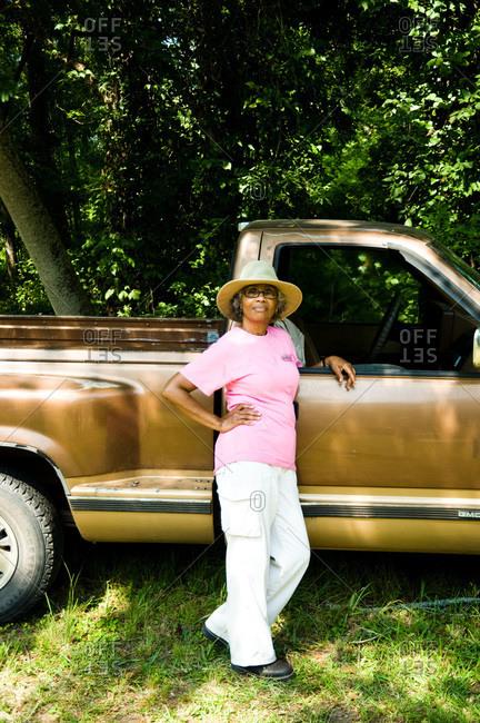 Colfax, Louisiana - May 28, 2012: Malva Kimble stands with her truck