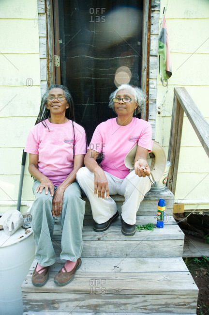 Colfax, Louisiana - May 28, 2012: Sisters Dianne and Malva sitting on the steps to their house