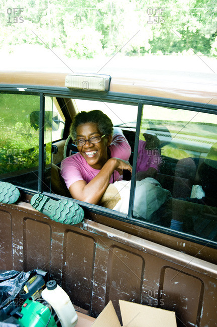 Colfax, Louisiana - May 28, 2012: Dianne Kimble smiles out of the window of her pickup truck