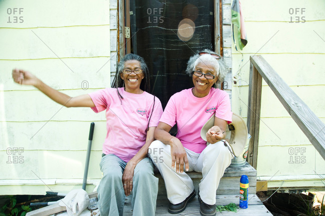 Colfax, Louisiana - May 28, 2012: Sisters Dianne and Malva smile while sitting on the steps to their house