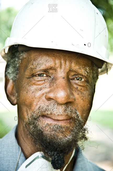 Colfax, Louisiana - May 28, 2012: A neighbor of Dianne Kimble in a hardhat
