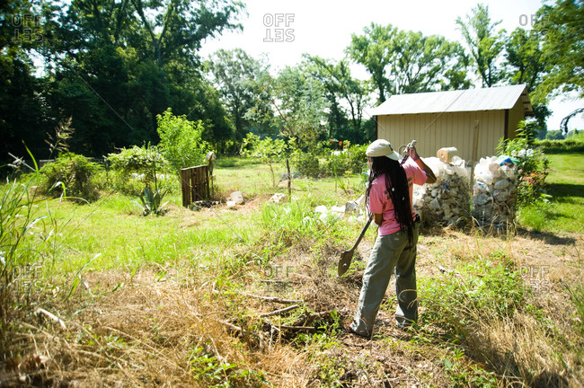 Colfax, Louisiana - May 28, 2012: Dianne Kimble turning some compost