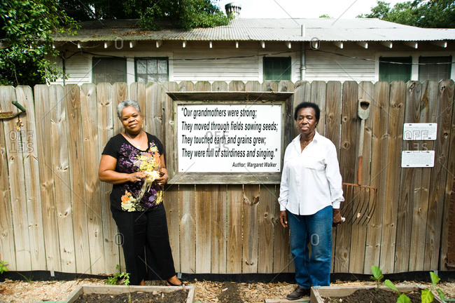 Donaldsonville, Louisiana - May 30, 2012: Kathe Hambrick-Jackson and friend standing by inspirational sign in the Freedom Garden at the River Road African American Museum