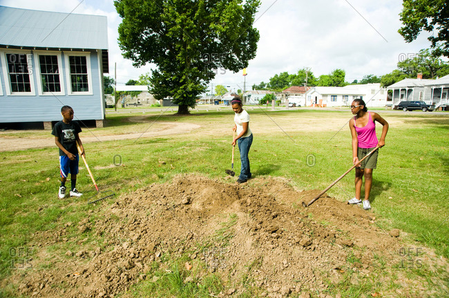 Donaldsonville, Louisiana - May 30, 2012: Three children breaking up soil for a new project at  the River Road African American Museum