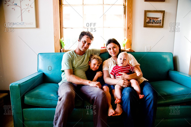 Arnaudville, Louisiana - May 29, 2012: The Michot family, Louis, Julien, Baby Lou and Ashlee, in their bousillage home