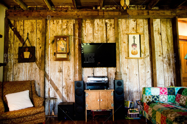 Arnaudville, Louisiana - May 29, 2012: The Michot's living room made with reclaimed barnboard walls and beams