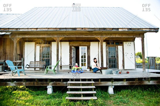 Arnaudville, Louisiana - May 29, 2012: Ashlee and Baby Lou Michot on the back porch of their bousillage home