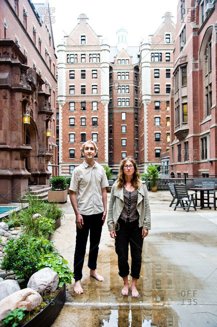 New York City, New York - June 14, 2011: Colin Schumacher and Marni Majorelle in a puddle next to a rain garden