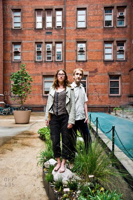 New York City, New York - June 14, 2011: Colin Schumacher and Marni Majorelle in a rain garden