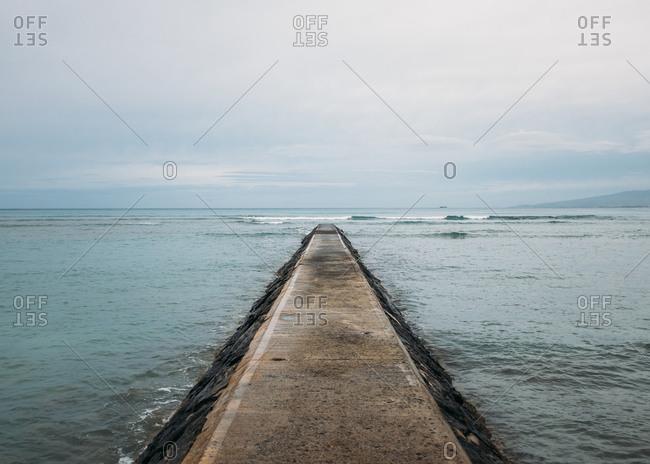 Stone pier running into ocean