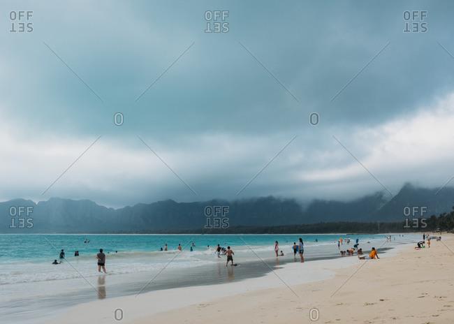Beach goers on cloudy beach