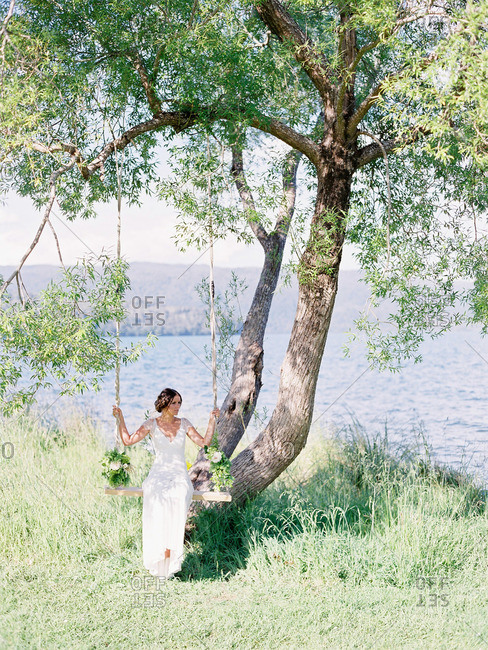 Bride on a tree swing