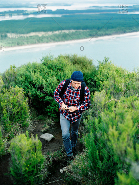 Young man hiking in rural hills
