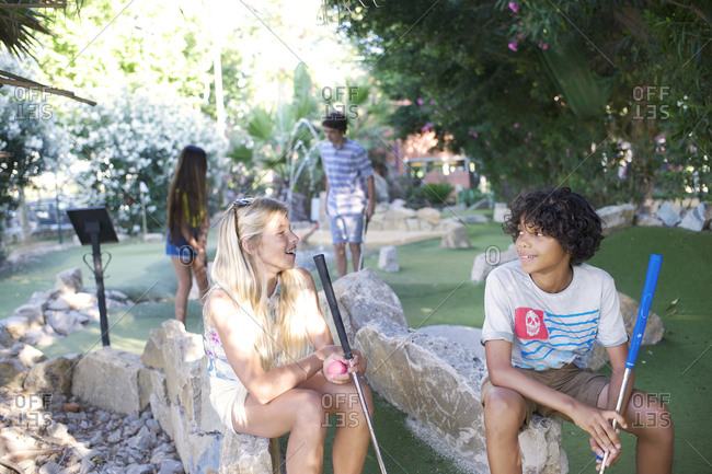 Group of adolescents on minigolf course