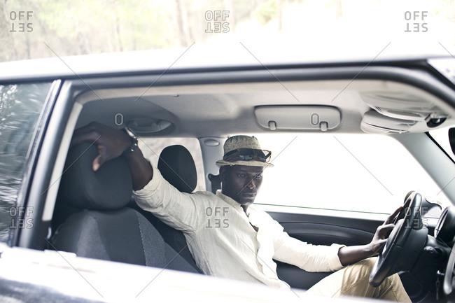 Man sitting relaxing in car
