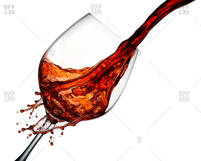 Red wine flowing into glass