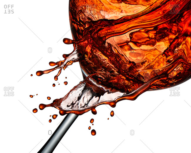 Red wine overflowing glass