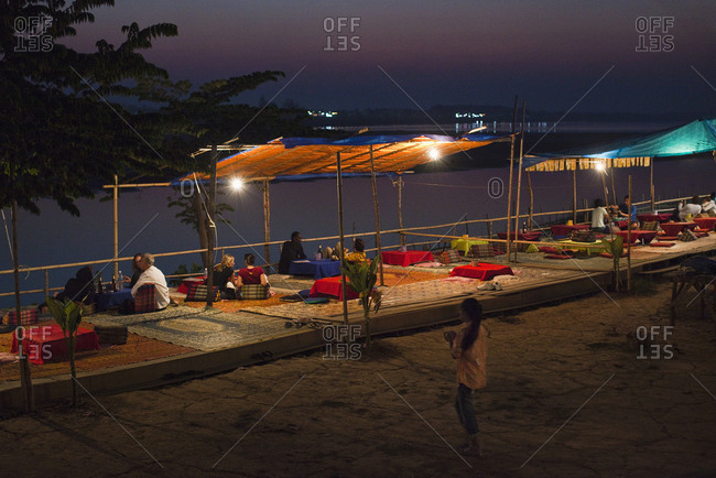 Open-air eateries by the Mekong River, Vientiane, Laos