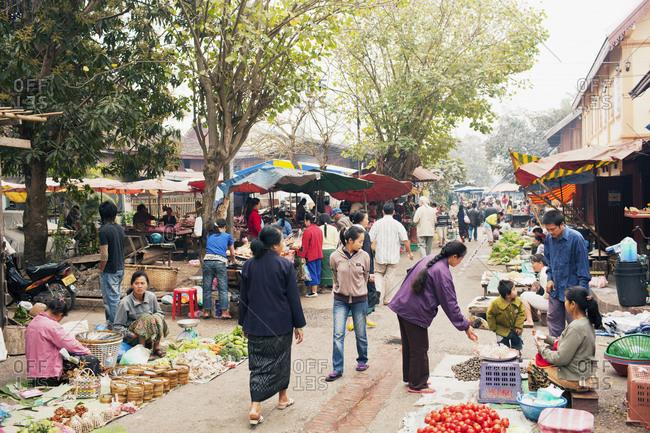 Luang Prabang, Laos - February 3, 2009: Street in morning market, Luang Prabang, Laos