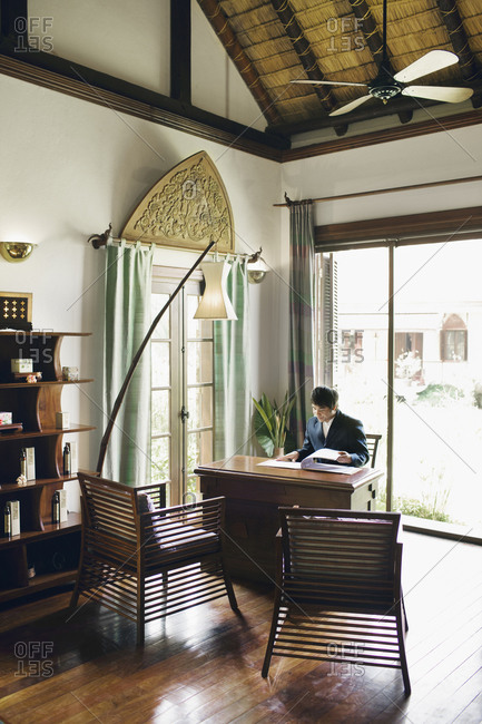 Receptionist in hotel, Luang Prabang, Laos
