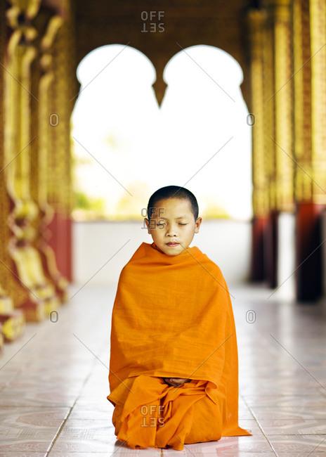 Luang Prabang, Laos - January 30, 2009: A portrait of young monk at Wat Manoran, Luang Prabang, Laos
